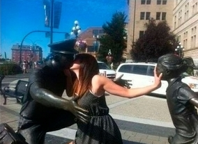 people interecting with statues