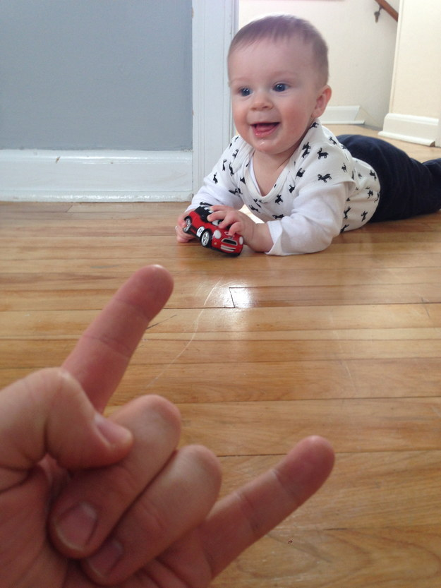 Instead of taking photos of just his son, Reda says the hand gesture makes him part of the story, too.