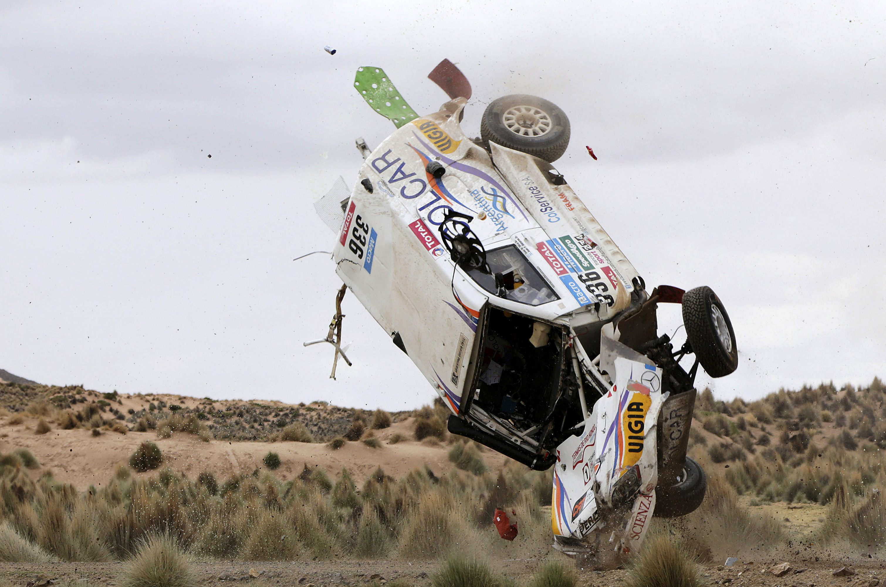 Argentine Juan Manuel Silva and Pablo Sisterna (not pictured) crash in their Mercedes car during the 7th stage of the Dakar Rally from Iquique to Uyuni