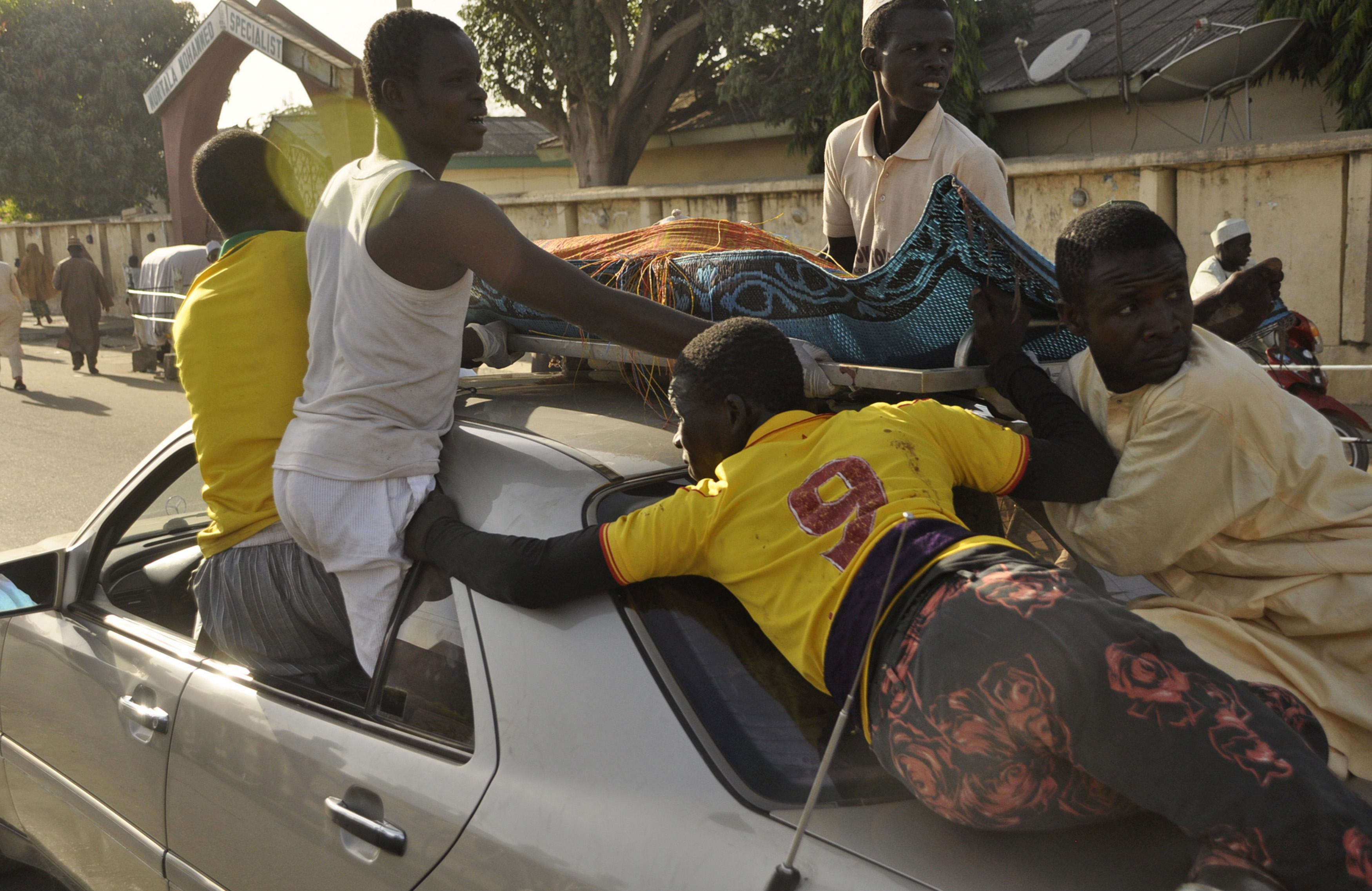 The remains of the Kano central mosque bombing victim is carried on the top of a car from the Murtala Mohammed specialist Hospital for burial according to Muslim rites, in Kano State